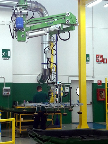 Handling large tractor sides in a production line using an overhead mounted intelligent lift assist device INDEVA Liftronic Air
