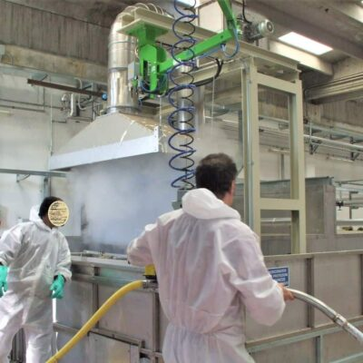 An INDEVA manipulator makes lthe use of a latex sprayer easy and effortless